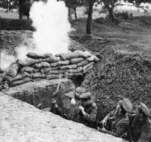 3 British soldiers in trench under fire during World War 1