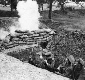 3 British soldiers in trench under fire during World War 1