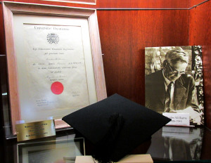 Museum display at the Wade Center featuring Charles Williams's honorary Masters of Arts degree from Oxford University, and the mortar board he wore during the ceremony.