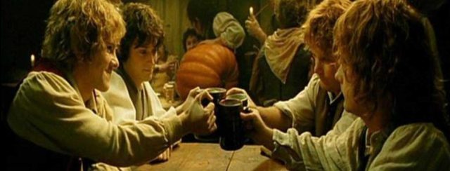hobbits-raising-a-pint-tolkienbirthdaytoast